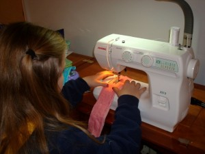 child sewing on a Janome sewing machine