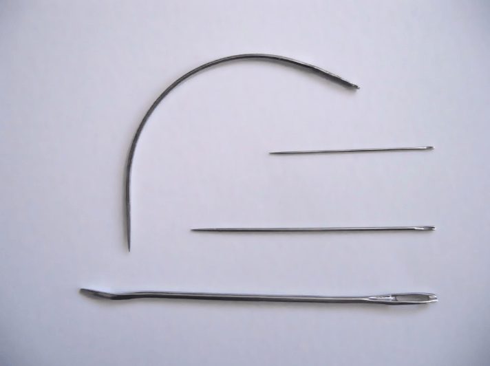 group-of-needles-and-a-thread